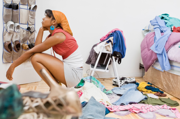 woman cleaning her closet