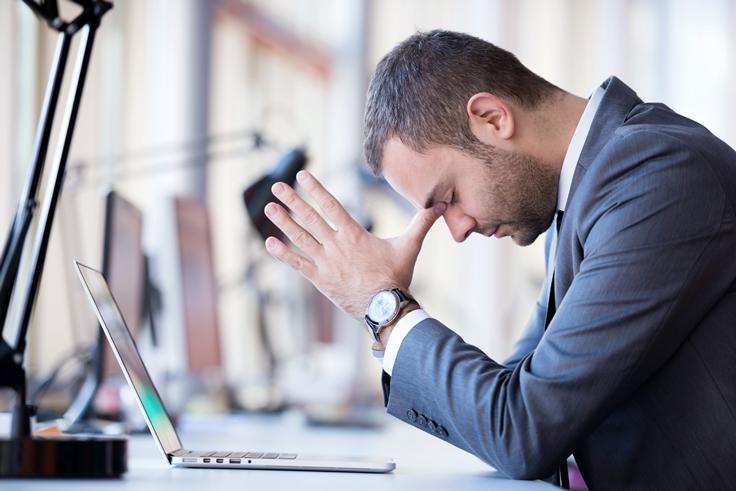 man at computer praying about giving